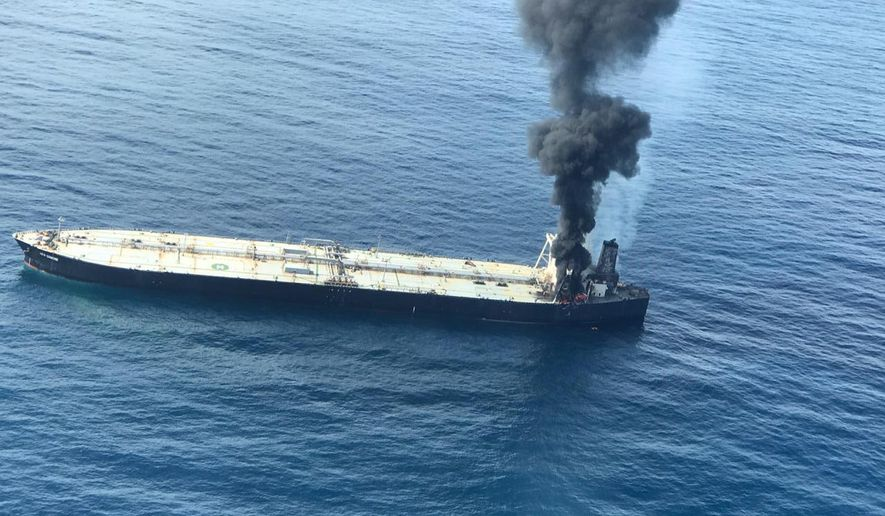 This photo released by Sri Lankan Air Force shows smoke rising after a fire broke out on a Panama-registered oil tanker about 38 nautical miles (70 kilometers) east of Sri Lanka, Thursday, Sept.3, 2020. (Sri Lankan Air Force via AP)