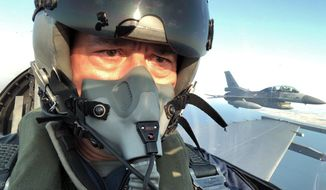 """Turkey's Defense Minister Hulusi Akar sits inside an F-16 jet fighter at a military air base in western city of Eskisehir, Turkey, Wednesday, Sep. 2, 2020, during a training flight over Turkish Monument in Gallipoli peninsula. Akar said Thursday that Washington's lifting the arms embargo against Greek Cypriot-administered Cyprus will lead to a deadlock. """"If you lift the embargo and try to disrupt the balance in this way, this will bring conflict, not peace,"""" he said.(Turkish Defense Ministry via AP, Pool)"""