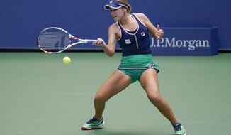 Sofia Kenin, of the United States, returns a shot to Leylah Fernandez, of Canada, during the second round of the US Open tennis championships, Thursday, Sept. 3, 2020, in New York. (AP Photo/Seth Wenig)