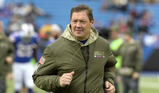 Then-Buffalo Bills offensive coordinator Rick Dennison runs on the field prior to an NFL football game, Sunday, Nov. 12, 2017, in Orchard Park, N.Y. Minnesota's offensive line remains a work in progress, but the Vikings have a trusted teacher to follow in Rick Dennison, the longtime position coach with a unique background in civil engineering. (AP Photo/Adrian Kraus, File)