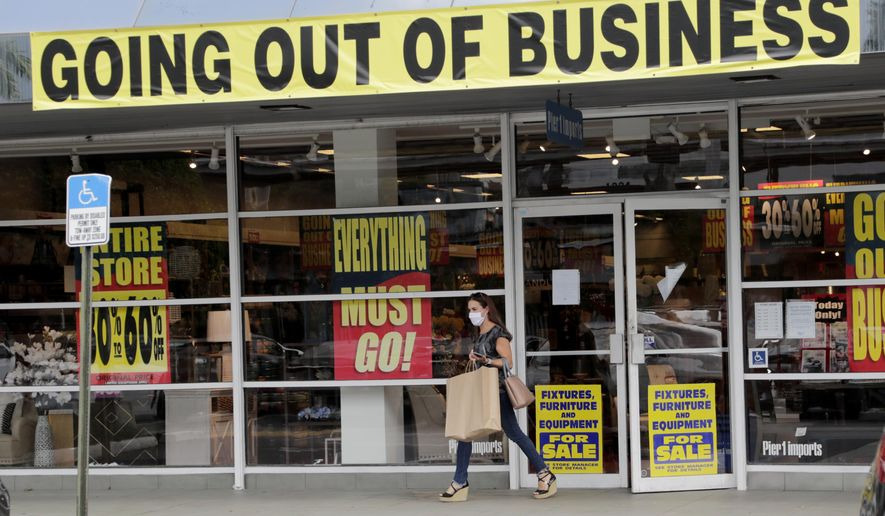 In this Aug. 6, 2020, file photo, a customer leaves a Pier 1 retail store, which is going out of business, during the coronavirus pandemic in Coral Gables, Fla. (AP Photo/Lynne Sladky, File)