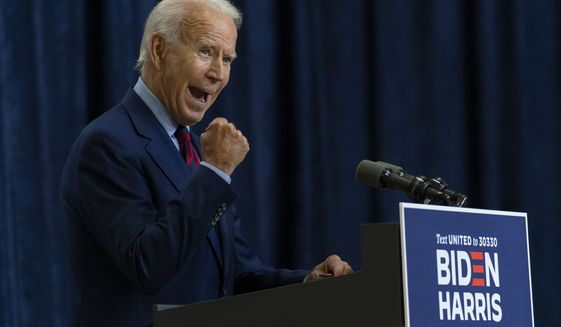 Democratic presidential candidate former Vice President Joe Biden shakes his fist as he speaks in Wilmington, Del., Friday Sept. 4, 2020. (AP Photo/Carolyn Kaster)