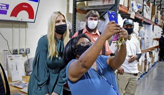 Ivanka Trump, daughter of President Donald Trump and a senior White House adviser, poses for a selfie with an unidentified woman while visiting Blessings of Hope in Leola, Pa. Friday, Sep. 4, 2020. Ivanka Trump, the eldest daughter of President Donald Trump and a senior White House adviser, visited the Lancaster County food bank Friday. (Blaine Shaha/LNP/LancasterOnline via AP)