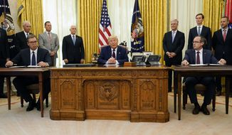 President Donald Trump participates in a signing ceremony with Serbian President Aleksandar Vucic, seated left, and Kosovar Prime Minister Avdullah Hoti, seated right, in the Oval Office of the White House, Friday, Sept. 4, 2020, in Washington. (AP Photo/Evan Vucci)