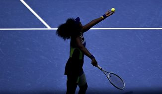 Naomi Osaka, of Japan, serves to Marta Kostyuk, of the Ukraine, during the third round of the US Open tennis championships, Friday, Sept. 4, 2020, in New York. (AP Photo/Seth Wenig)