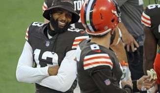 Cleveland Browns quarterback Baker Mayfield, right, and wide receiver Odell Beckham Jr. talk during the NFL football team's scrimmage Friday, Sept. 4, 2020, in Cleveland. (Joshua Gunter/Cleveland.com via AP)
