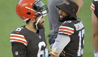Cleveland Browns quarterback Baker Mayfield and wide receiver Odell Beckham Jr. talk during an NFL football scrimmage at FirstEnergy Stadium in Cleveland, Friday, Sept. 4, 2020. (Joshua Gunter/Cleveland.com via AP)