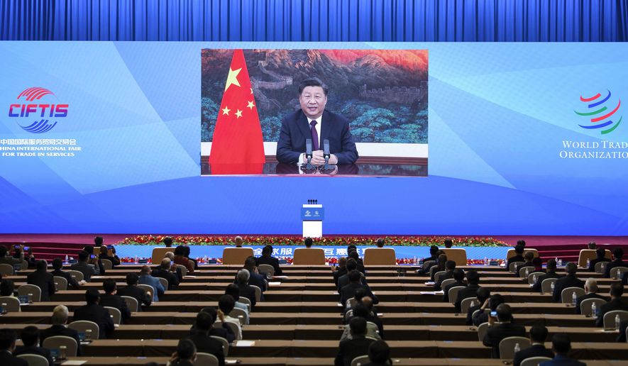 In this photo released by Xinhua News Agency, Chinese President Xi Jinping addresses the Global Trade in Services Summit of the 2020 China International Fair for Trade in Services (CIFTIS) via video in Beijing, China on Friday, Sept. 4, 2020. Chinese President Xi Jinping said China will further open to the outside world at the opening ceremony of a massive trade fair in Beijing, the first this large scale trade event integrating online and offline exchanges since the coronavirus outbreak. (Li Tao/Xinhua via AP)