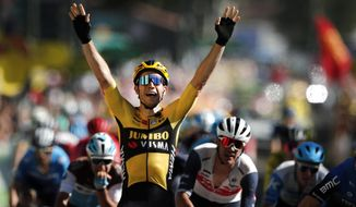 Belgium's Wout Van Aert celebrates as he crosses the finish line to win the seventh stage of the Tour de France cycling race over 168 kilometers (105 miles), with start in Millau and finish in Lavaur, Friday, Sept. 4, 2020. (Benoit Tessier/Pool via AP)