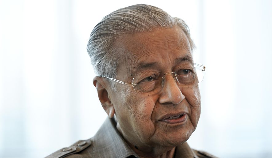 Former Prime Minister Mahathir Mohamad speaks during an interview with The Associated Press in Kuala Lumpur, Friday, Sept. 4, 2020. Mahathir said Friday that Malaysia's governing coalition isn't likely to call for early general elections due to political infighting and foresee his new ethnic Malay party to play the role of kingmaker in the next polls. (AP Photo/Vincent Thian)