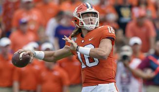In this Oct. 12, 2019, file photo, Clemson's Trevor Lawrence throws a pass during the first half of an NCAA college football game against Florida State, in Clemson, S.C. Lawrence is a candidate for the 2020 Heisman Trophy award.  (AP Photo/Richard Shiro, File)