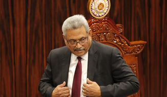FILE - In this Friday, Jan. 3, 2020, file photo, Sri Lankan President Gotabaya Rajapaksa leaves after addressing parliament during the ceremonial inauguration of the session, in Colombo, Sri Lanka. Sri Lanka's government in early September has proposed changes to the constitution to aggrandize powers of the president, that will allow him hold key ministries and appoint officials to key positions, powers that were taken away by  a reformist government elected in 2015. The draft of the 20th Amendment to the  constitution will allow Rajapaksa to appoint top  judges, police chief, members of the public service, elections, bribery and  human rights commissions at his discretion. (AP Photo/Eranga Jayawardena, File)