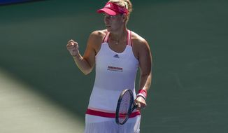 Angelique Kerber, of Germany, reacts after winning a match against Ann Li, off the United States, during the third round of the US Open tennis championships, Friday, Sept. 4, 2020, in New York. (AP Photo/Seth Wenig)