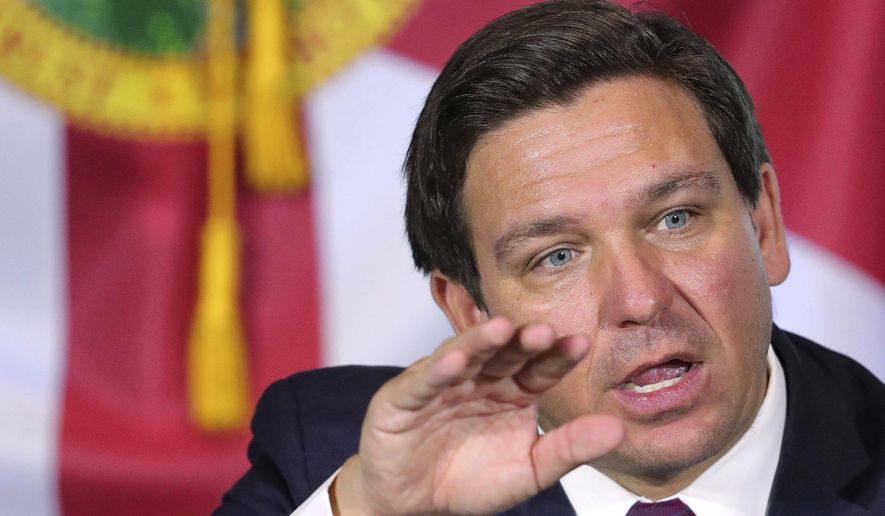 Florida Gov. Ron DeSantis speaks at a roundtable discussion with theme park leaders about safety protocols and the impact of the coronavirus pandemic, Wednesday, Aug. 26, 2020, Orlando, Fla.  (Joe Burbank/Orlando Sentinel via AP) **FILE**
