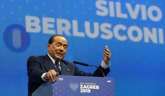 In this Nov. 21, 2019, file photo, Silvio Berlusconi, Italian former premier and president of Forza Italia (Go Italy) party speaks during the European Peoples Party (EPP) congress in Zagreb, Croatia. Sen. Lucia Ronzulli, who is a top aide to Silvio Berlusconi told RAI state TV Friday, Sept. 4, 2020, that the former premier was admitted to a Milan hospital early Friday as a precaution to monitor his coronavirus infection after testing positive for COVID-19 earlier in the week. (AP Photo/Darko Vojinovic, file)