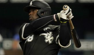 Chicago White Sox's Luis Robert hits a three-run home run during the seventh inning of a baseball game against the Kansas City Royals at Kauffman Stadium in Kansas City, Mo., Thursday, Sept. 3, 2020. (AP Photo/Orlin Wagner)