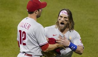 Philadelphia Phillies' Bryce Harper, right, reacts alongside Neil Walker (12) after being thrown out of the team's baseball game against the New York Mets by umpire Roberto Ortiz during the fifth inning Saturday, Sept. 5, 2020, in New York. (AP Photo/John Minchillo)