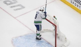Vancouver Canucks' J.T. Miller reacts to an empty-net goal by the Vegas Golden Knights during the third period of Game 7 of an NHL hockey second-round playoff series, Friday, Sept. 4, 2020, in Edmonton, Alberta. (Jason Franson/The Canadian Press via AP)
