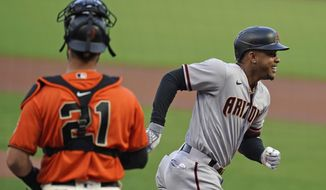 Arizona Diamondbacks' Ketel Marte heads for the dugout after hitting a home run off San Francisco Giants starting pitcher Tyler Anderson in the first inning of a baseball game Friday, Sept. 4, 2020, in San Francisco. Giants catcher Joey Bart, left, looks on. (AP Photo/Eric Risberg)