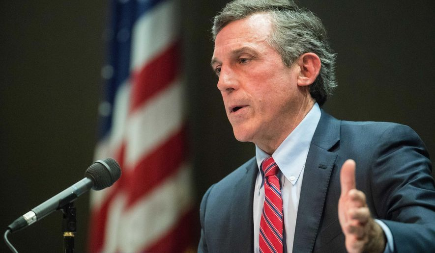 Delaware Gov. John Carney speaks during a briefing on the coronavirus pandemic, Tuesday, April 14, 2020, at the Carvel State Office Building in Wilmington, Del. Finding Republican candidates to run for office in solid-blue Delaware can sometimes be a challenge. But there's no shortage of GOP contenders hoping to unseat Carney this year. Six candidates are competing in the upcoming GOP gubernatorial primary election. (Jerry Habraken/The News Journal via AP)