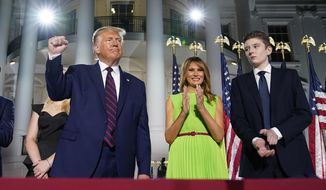 """President Donald Trump, first lady Melania Trump and Barron Trump stand on the South Lawn of the White House on the fourth day of the Republican National Convention, Thursday, Aug. 27, 2020, in Washington.  It's called a """"permission structure."""" President Donald Trump's campaign is trying to construct an emotional and psychological gateway to help disenchanted voters feel comfortable voting for the president again despite their reservations about him personally. (AP Photo/Evan Vucci)"""