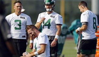 New York Jets quarterbacks Sam Darnold (14), David Fales (3), James Morgan (4) and Mike White (8) practices drills during a practice at the NFL football team's training camp in Florham Park, N.J., Saturday, Aug. 22, 2020. (AP Photo/Adam Hunger)