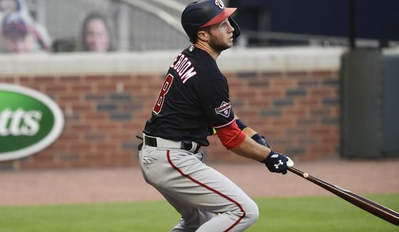 Washington Nationals' Carter Kieboom singles on a fly ball to left field during the first inning of a baseball game against the Atlanta Braves, Saturday, Sept. 5, 2020, in Atlanta. Trea Turner scored on the play. (AP Photo/John Amis)