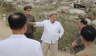 "In this Saturday, Sept. 5, 2020, photo provided by the North Korean government, North Korea leader Kim Jong Un talks to officials as he visits a damaged area in the South Hamgyong province, North Korea, following a typhoon known as Maysak. Independent journalists were not given access to cover the event depicted in this image distributed by the North Korean government. The content of this image is as provided and cannot be independently verified. Korean language watermark on image as provided by source reads: ""KCNA"" which is the abbreviation for Korean Central News Agency. (Korean Central News Agency/Korea News Service via AP)"