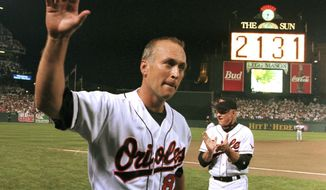 FILE - In this Sept. 6, 1995, file photo, Baltimore Orioles' Cal Ripken Jr. waves to the crowd as the sign in centerfield reads 2,131, signifying Ripken had broken Lou Gehrig's record of playing in 2,130 consecutive games, at Camden Yards in Baltimore. It has been 25 years since Ripken broke Gehrig's major league record for consecutive games played, a feat the Orioles star punctuated with an unforgettable lap around Camden Yards in the middle of his 2,131st successive start. (AP Photo/Denis Paquin, File)