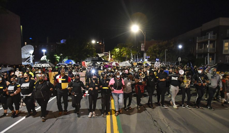Demonstrators march through the streets in Rochester, N.Y., Friday, Sept. 4, 2020, protesting the death of Daniel Prude. Prude apparently stopped breathing as police in Rochester were restraining him in March 2020 and died when he was taken off life support a week later. (AP Photo/Adrian Kraus)
