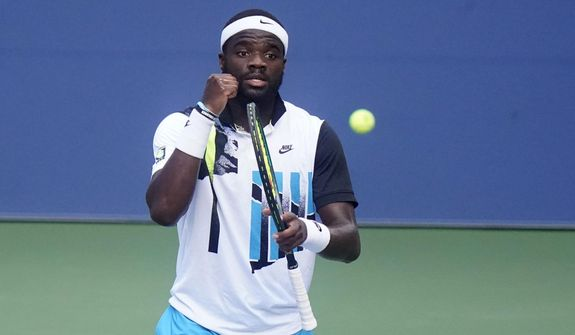 Frances Tiafoe, of the United States, reacts after winning a match against Marton Fucsovics, of Hungary, during the third round of the US Open tennis championships, Saturday, Sept. 5, 2020, in New York. (AP Photo/Frank Franklin II) **FILE**