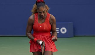 Serena Williams, of the United States, reacts during a match against Sloane Stephens, of the United States, during the third round of the US Open tennis championships, Saturday, Sept. 5, 2020, in New York. (AP Photo/Seth Wenig)