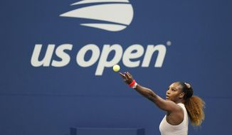Serena Williams, of the United States, serves to Margarita Gasparyan, of Russia, during the third round of the U.S. Open tennis championships, Thursday, Sept. 3, 2020, in New York. (AP Photo/Frank Franklin II)