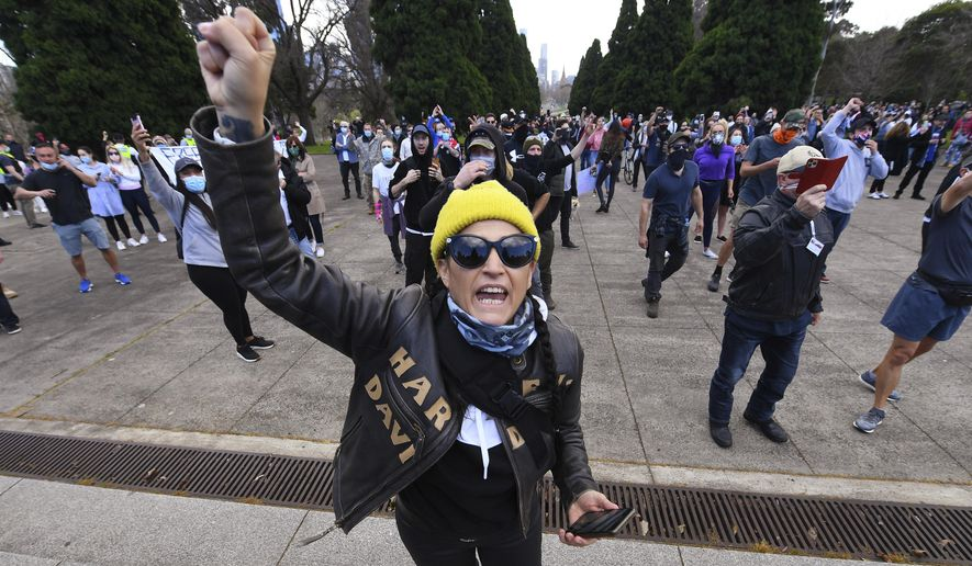 """People gather at a so-called """"Freedom Day"""" protest in Melbourne, Saturday, Sept. 5, 2020. Police in Australia's hardest-hit Victoria state are urging people to stay away from rallies protesting the lockdown in Melbourne. (James Ross/AAP Image via AP)"""
