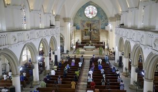The congregation practises social-distancing to curb the spread of the coronavirus during a Sunday mass at the Holy Cross Cathedral in Lagos, Nigeria Sunday, Aug. 30, 2020. The COVID-19 pandemic is testing the patience of some religious leaders across Africa who worry they will lose followers, and funding, as restrictions on gatherings continue. (AP Photo/Sunday Alamba)