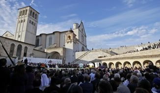 FILE - In this Tuesday, Sept. 20, 2016 file photo, a moment of the closing event of an inter-religious prayer gathering, in front of the Basilica of St. Francis, Assisi, Italy. The Franciscan friars in Assisi say Pope Francis will journey there next month to sign a new encyclical, expected to stress the value of brotherly relations during and after the pandemic, in what could be his first visit outside of the Rome area since Italy went into lockdown. (AP Photo/Alessandra Tarantino, File)