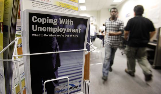 Government figures reveal that in the second quarter, the number of hours worked dropped by the largest amount in more than 70 years. (Associated Press)