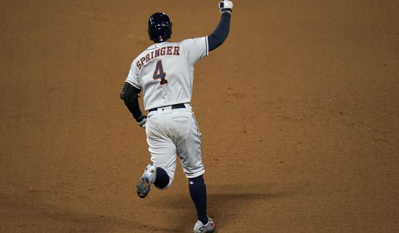 Houston Astros' George Springer celebrates his two-run home run during the fifth inning of the second baseball game of the team's doubleheader against the Los Angeles Angels, Saturday, Sept. 5, 2020, in Anaheim, Calif. (AP Photo/Jae C. Hong)