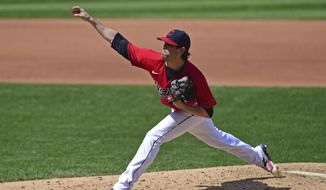 Cleveland Indians starting pitcher Shane Bieber (57) delivers during the fourth inning of a baseball game against the Milwaukee Brewers, Sunday, Sept. 6, 2020, in Cleveland. (AP Photo/David Dermer)