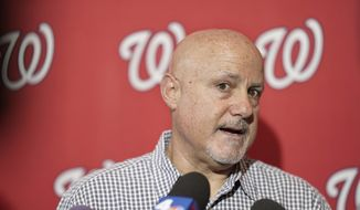 "In this Jan. 11, 2020, file photo, Washington Nationals general manager Mike Rizzo talks with members of the media during the team's ""Winterfest"" baseball fan festival in Washington. The  Nationals and Rizzo finalized a multiyear contract extension Saturday, Sept. 5, 2020. The 59-year-old Rizzo, who also holds the title of president of baseball operations, built the team that won the 2019 World Series championship. (AP Photo/Sait Serkan Gurbuz, File) **FILE**"