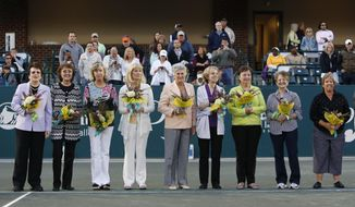 FILE - In this April 7, 2012, file photo, members of the original nine women, from left to right, Billie Jean King, Peaches Bartkowicz, Kristy Pigeon, Valerie Ziegenfuss, Judy Tegart Dalton, Julie Heldman, Kerry Melville Reid, Nancy Richey and Rosie Casals, who helped start the women's professional tennis tour are honored at the Family Circle Cup tennis tournament in Charleston, S.C. The nine signed a dollar contract 50 years ago, and it turned into millions for female tennis players. They were tired of being squeezed out of events by promoters and paid 10 times less than men. (AP Photo/Mic Smith, File)