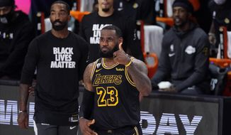 Los Angeles Lakers' LeBron James (23) gives a thumbs-up during the second half of an NBA conference semifinal playoff basketball game against the Houston Rockets Sunday, Sept. 6, 2020, in Lake Buena Vista, Fla. (AP Photo/Mark J. Terrill)