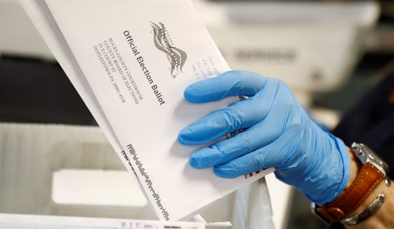 In every U.S. presidential election, thousands of ballots are rejected and never counted. They may have arrived after Election Day or were missing a voter's signature. That number will be far higher this year as the coronavirus pandemic forces tens of millions of Americans to vote by mail for the first time. (Associated Press/File) ** FILE **