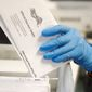 In every U.S. presidential election, thousands of ballots are rejected and never counted. They may have arrived after Election Day or were missing a voter's signature. That number will be far higher this year as the coronavirus pandemic forces tens of millions of Americans to vote by mail for the first time. (Associated Press/File)