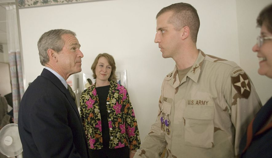 Capt. Daniel Gade, a double Purple Heart recipient who got a visit from President Bush in 2005, is one of a number of military veterans seeking federal office in high-profile races this year. (Associated Press/File)