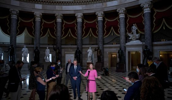 FILE - In this Aug. 7, 2020, file photo House Speaker Nancy Pelosi of Calif., center, accompanied by Senate Minority Leader Sen. Chuck Schumer of N.Y., left, speaks to members of the media after meeting with Treasury Secretary Steven Mnuchin and White House Chief of Staff Mark Meadows as they continue to negotiate a coronavirus relief package on Capitol Hill in Washington. The battle for control of Congress this fall is solidifying into a race about President Donald Trump. (AP Photo/Andrew Harnik, File)