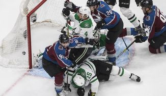 Colorado Avalanche's Nazem Kadri (91) scores against Dallas Stars' goalie Anton Khudobin (35) as Avalanche's Nathan MacKinnon (29), Stars' Miro Heiskanen (4) and Stars' Blake Comeau (15) battle during second-period NHL Western Conference Stanley Cup playoff game action in Edmonton, Alberta, Friday, Sept. 4, 2020. (Jason Franson/The Canadian Press via AP)
