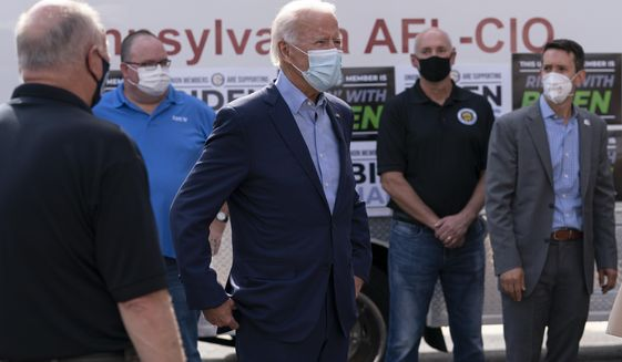 Democratic presidential candidate former Vice President Joe Biden talks with union leaders after taking photographs outside the AFL-CIO headquarters in Harrisburg, Pa., Monday, Sept. 7, 2020. (AP Photo/Carolyn Kaster)
