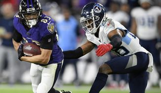 FILE - In this Jan. 11, 2020, file photo, Tennessee Titans cornerback Logan Ryan (26) hits Baltimore Ravens wide receiver Willie Snead (83) during the second half of an NFL divisional playoff football game in Baltimore. Ryan is thrilled to be back in New Jersey. The former Rutgers start is looking for a apartment for him and his pit bulls and willing to do anything to help the New York Giants win this season. (AP Photo/Nick Wass, File)
