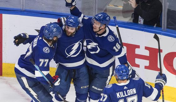 Tampa Bay Lightning's Victor Hedman (77), Brayden Point (21), Ondrej Palat (18) and Alex Killorn (17) celebrate a goal during second-period NHL Eastern Conference final playoff game action against the New York Islanders in Edmonton, Alberta, Monday, Sept. 7, 2020. (Jason Franson/The Canadian Press via AP)
